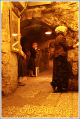 Women praying at the closest point to the Holy of Holies, Western Wall Tunnel.
