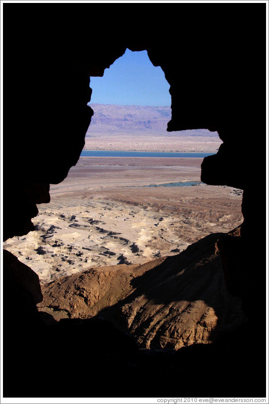 View of the desert and dead sea through a hole in the South Gate, desert fortress of Masada.