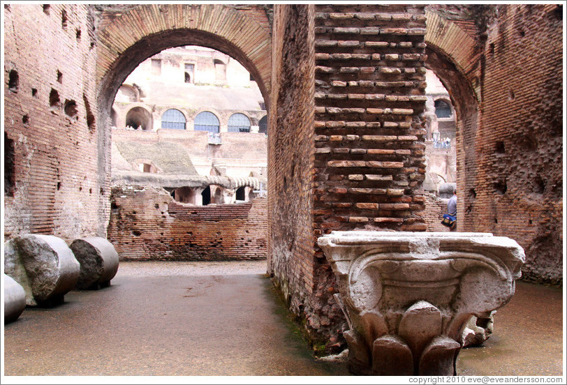 Arches and the top of an Ionic column.  The Colosseum.