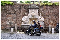 Scooter riders in front of Fontana del Mascherone (Fountain of the Mask) (1626).