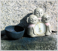 Offering.  Three-alien alarm clock.  Mt. Osorezan.