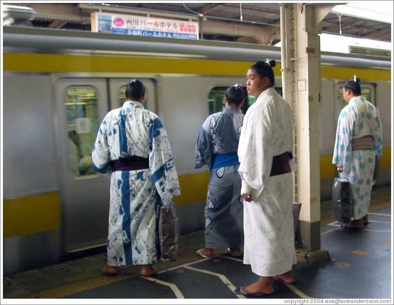 Sumo wrestlers waiting for the JR train.