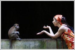 Monkey and girl conversing, Batu Caves.