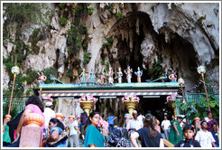 People and statues at the entrance to Batu Caves.