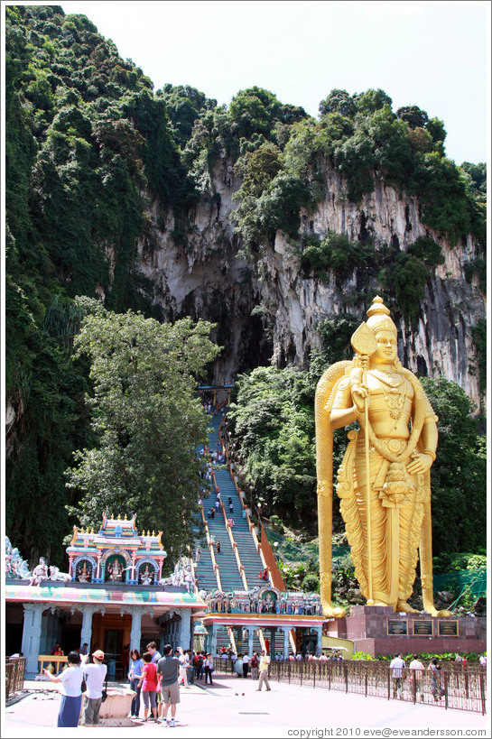 Stairway leading into Batu Caves, with Lord Murugan statue presiding.