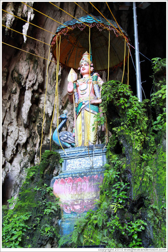 Statue of woman and peacock, Batu Caves.