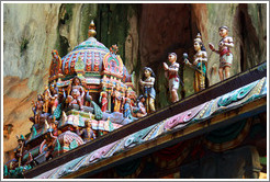 Figures on roof, temple, 2nd level, Batu Caves.