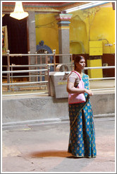 Woman in front of Main Temple, Batu Caves.