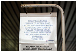 "Sign declaring that only ""bona fide"" passengers may board Malaysia Airlines flights, Kuala Lumpur International Airport."