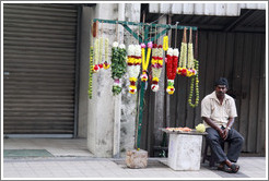 Man selling flower wreaths, Jalan Tun HS Lee.