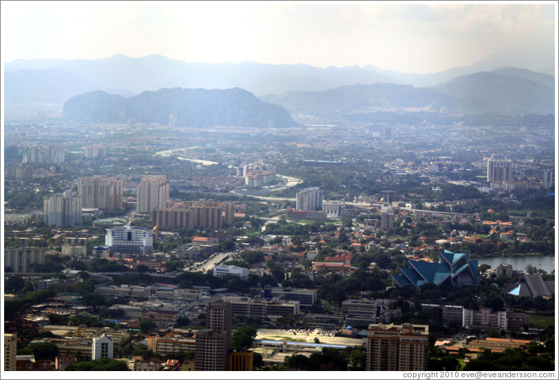 View of Kuala Lumpur from the KL Tower.  The large hill on the left in the background contains the Batu Caves.