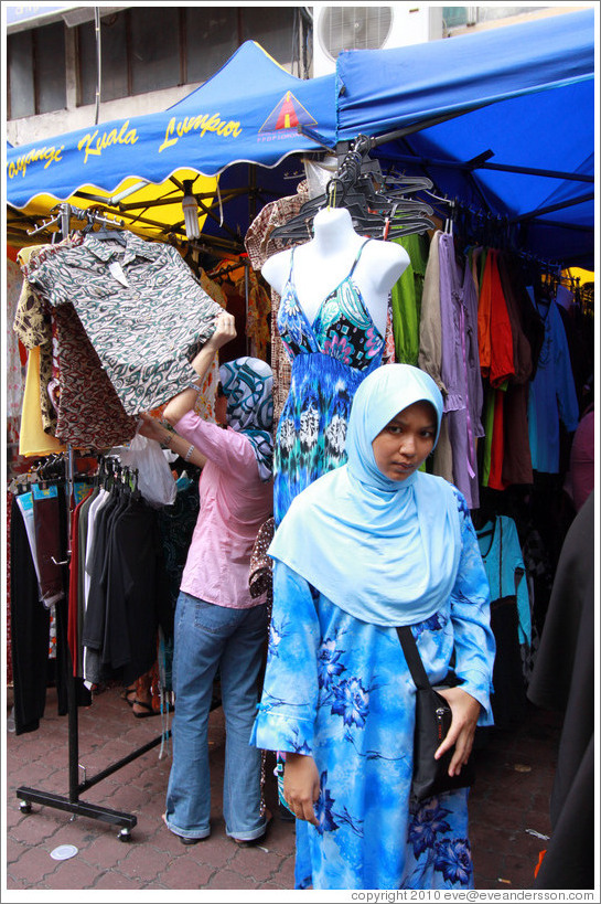 Woman in front of a mannequin at the market on Lorong Tuanku Abdul Rahman.