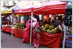 Women at a stall selling jackfruit at the market on Lorong Tuanku Abdul Rahman.