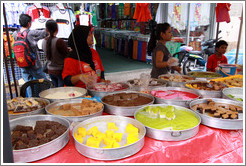 Women selling sweets at the market on Lorong Tuanku Abdul Rahman.
