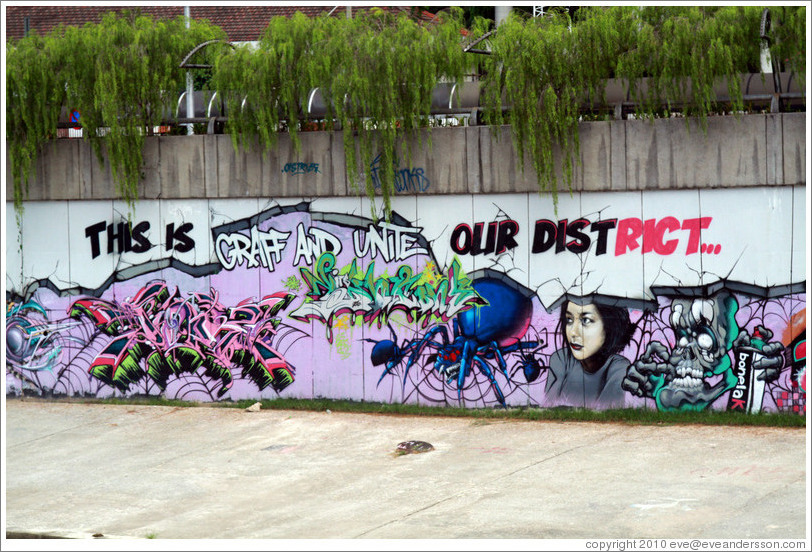 "Graffiti at the bank of the Sungai Kelang reading ""This is graff and unite our district."""
