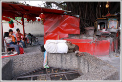 Man sleeping outside Kuan Yin Teng (Temple of the Goddess of Mercy).