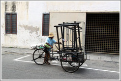Man with a bicycle cart.