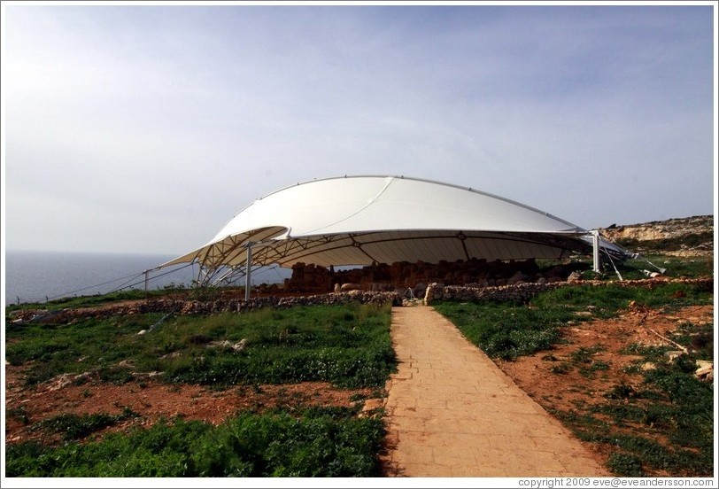 Mnajdra, a megalithic temple complex, under a high-tech protective covering.