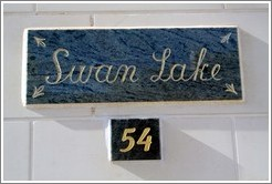 """Swan Lake"" nameplate on a house."