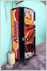 Vending machine selling Kinnie, a citrusy  Maltese soft drink.