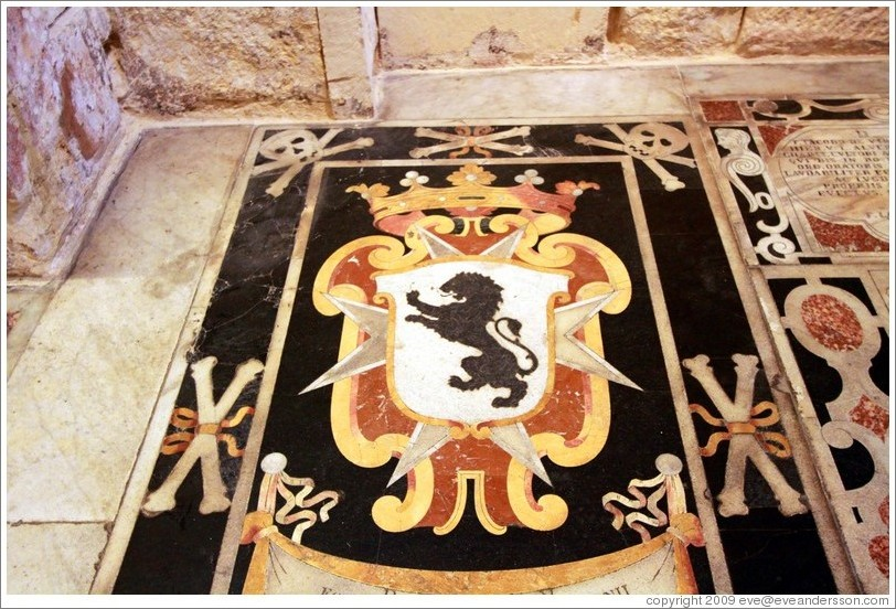 Floor decoration containing a lion and skulls and crossbones, St. Johns Co-Cathedral (Kon-Katidral ta' San Ġwann).