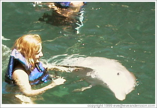 Eve swims with the dolphins.  Xcaret.