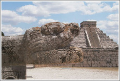 The monster is munching on the pyramid of Kukulcán.  Chichen Itza.
