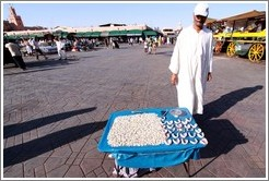 Man with table containing teeth, Jemaa el Fna.