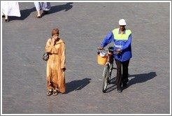 Woman and man with a bike, Jemaa el Fna.