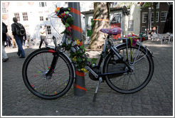 Bicycle decorated with flowers.