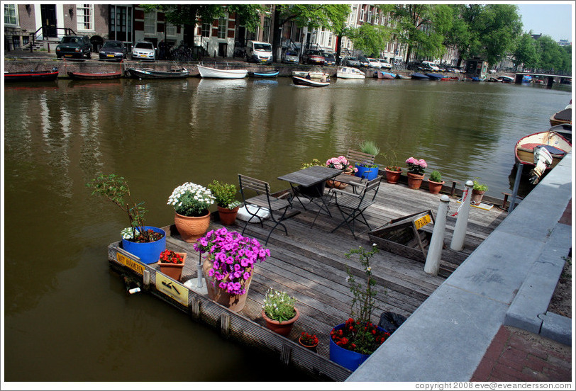 Dock with flowers, Singel canal, Centrum district.