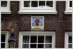 """Dat rosa mel apibus in liefde bloeiende"" (something about blooming love). Egelantiersgracht canal, Jordaan district."