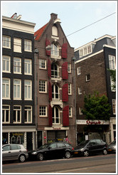 Building with red shutters and Manzano Restaurant.  Rozengracht, Jordaan district.