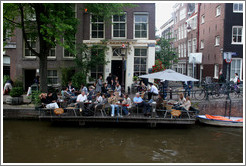 Restaurant with floating outdoor patio.  Egelantiersgracht canal, Jordaan district.