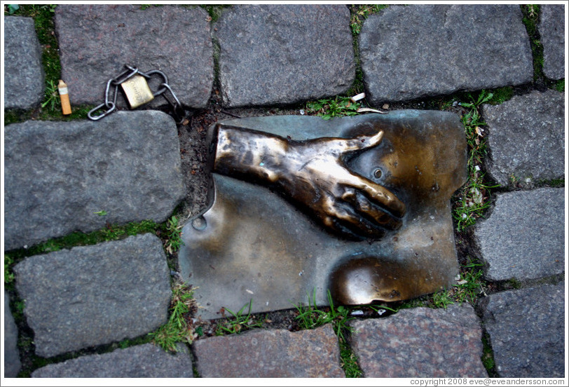 Sculpture of hand and breasts embedded in sidewalk.  Red Light district.