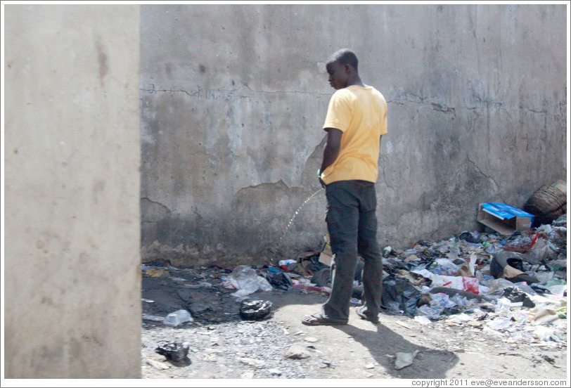Man urinating. Lagos Island.