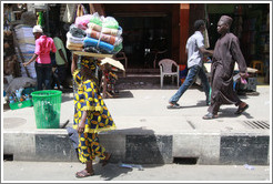 Woman with a bundle of cloths on her head.