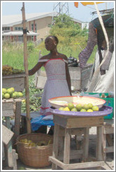 Girl selling fruit. Victoria Island.