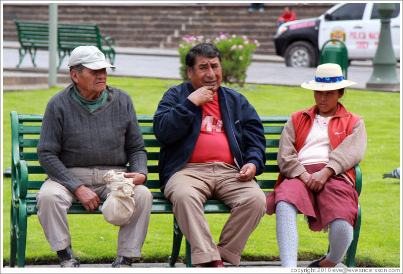Two men and a woman on a bench, Plaza de Armas.
