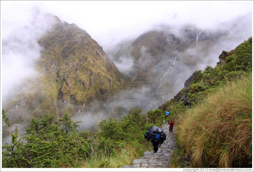 Porters climbing the steps of the Inca Trail.