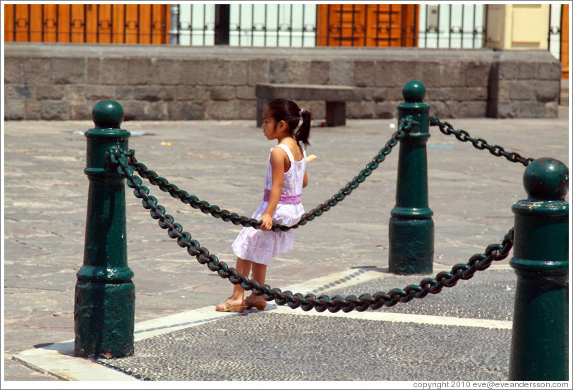 Girl resting on a chain, Iglesia de San Francisco, Historic Center of Lima.