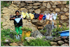 Woman hanging underwear to dry.
