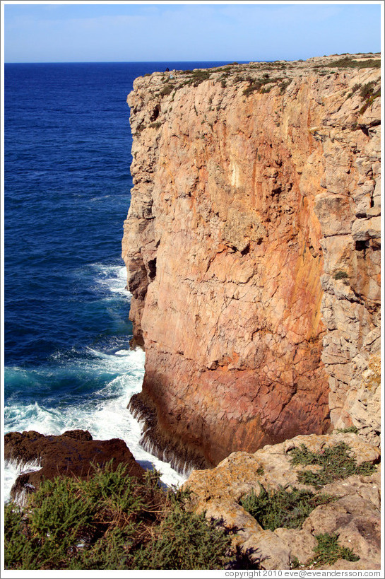 A barely visible fisherman fishes from this tall cliff at the Fortaleza de Sagres (Sagres Fortress).