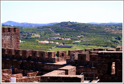 Silves Castle, with green fields behind it.