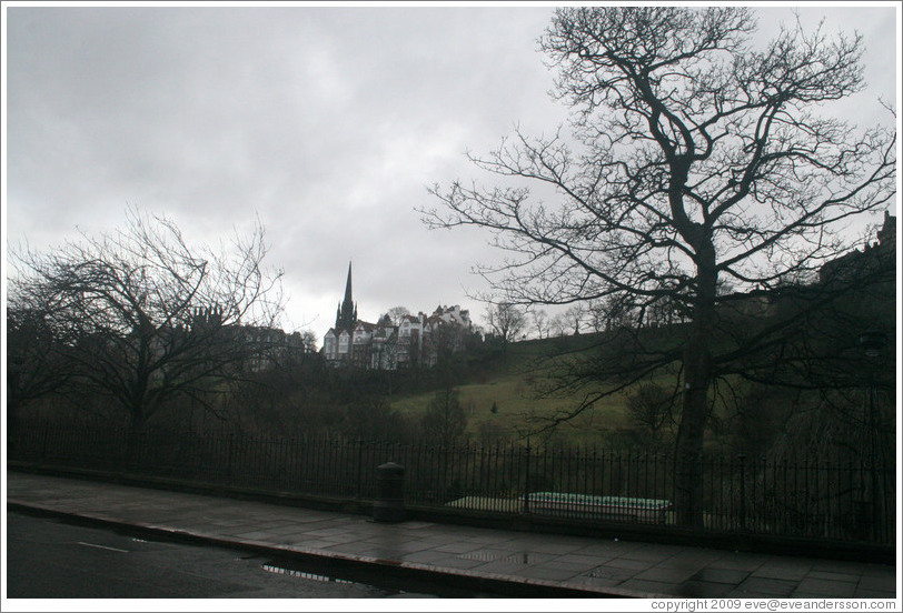 Princes Street Gardens on an overcast day.  In the background are buildings designed by Sir Patrick Geddes in 1893.