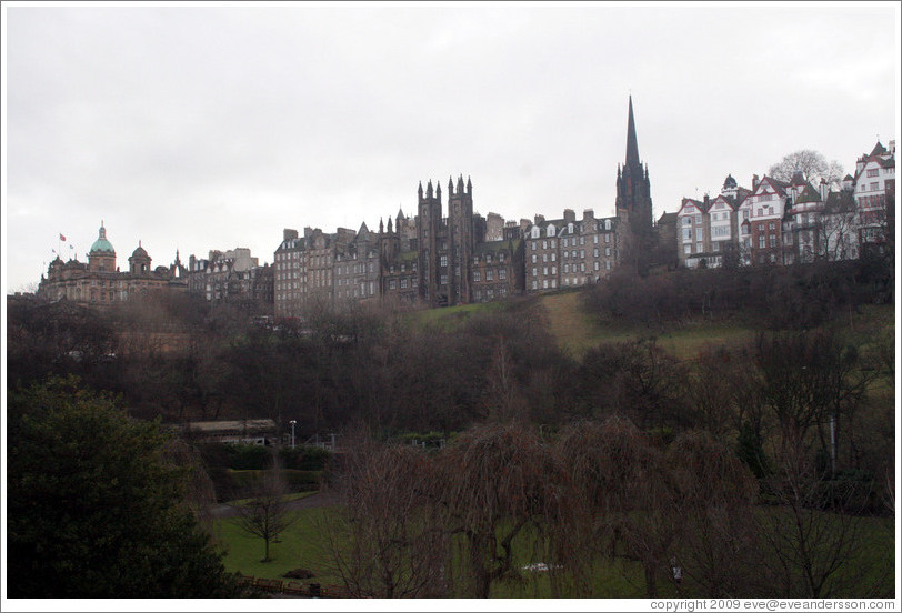 Princes Street Gardens on an overcast day.  In the background are buildings designed by Sir Patrick Geddes in 1893 and other Old Town buildings.