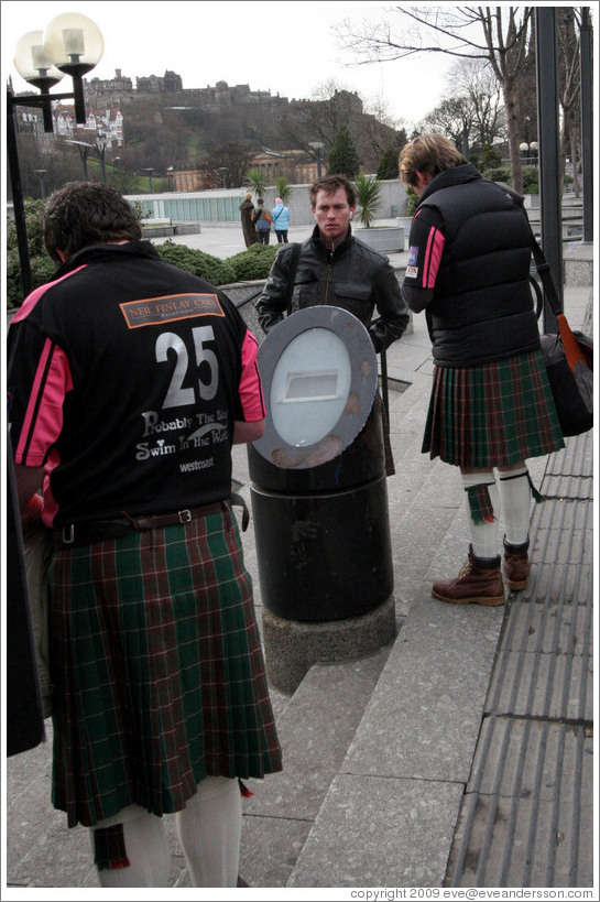 Rugby fans wearing kilts.  Princes Street.