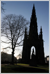 Silhouette of Scott Monument and tree.
