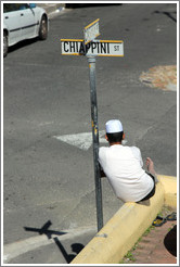 Man resting against street sign, Bo-Kaap.