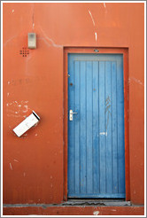 Orange building with blue door. Chiappini Street, Bo-Kaap.